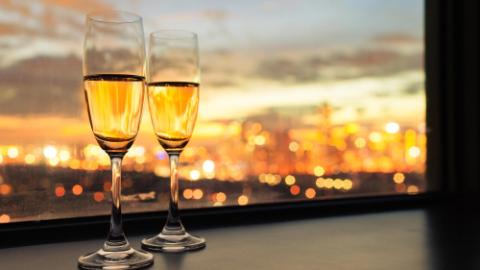Two glasses of champagne with city view